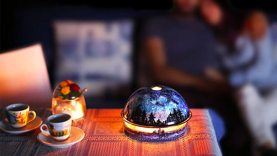 A personal mini fireplace that's powered by candles