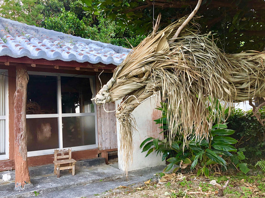 Dragon sculpture peers into Japanese house