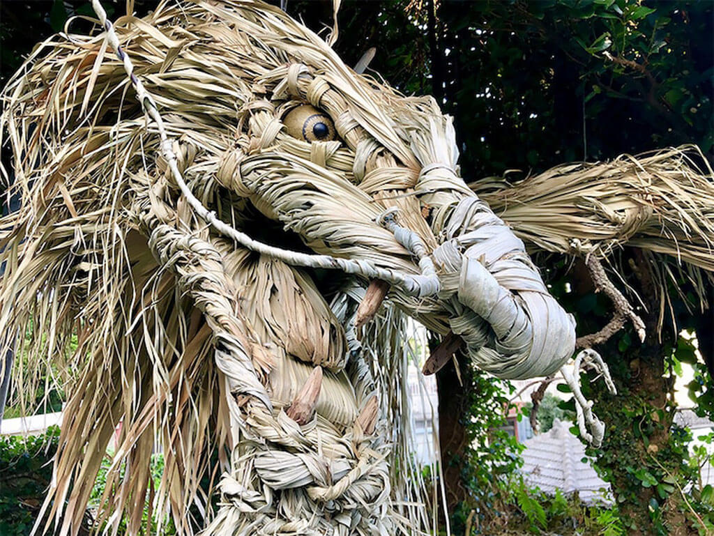 Dragon sculpture made from palm leaves and wood
