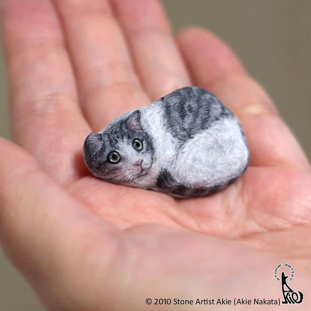 Realistic animals painted on rocks