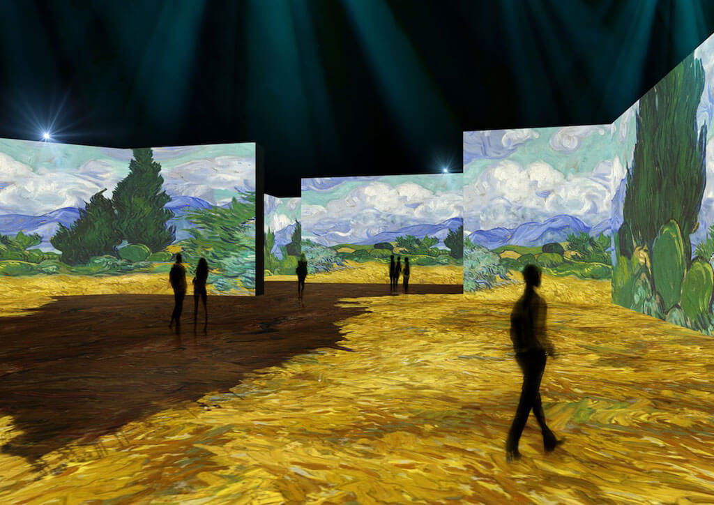 Digital projectors allow visitors to walk among the art