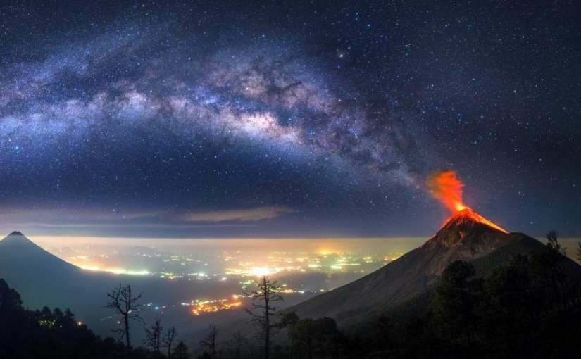 Someone Captured a Volcano Pouring Fire Into the Milky Way