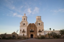 A visitor stands in the doorway of the San Xavier del Bac church. The church and mission are located nine miles south of Tucson, Ariz., on the reservation of the n the reservation of the Tohono O'odham people.
