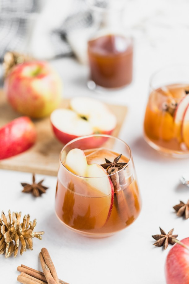 Apple cider cocktail with bourbon, apple cider syrup, and walnut bitters.
