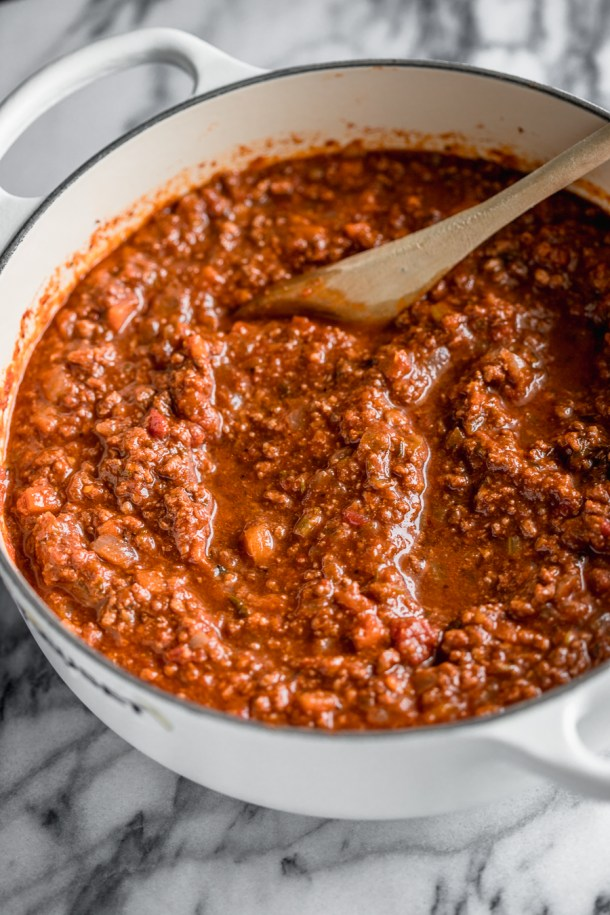 White pot of a red meat sauce.