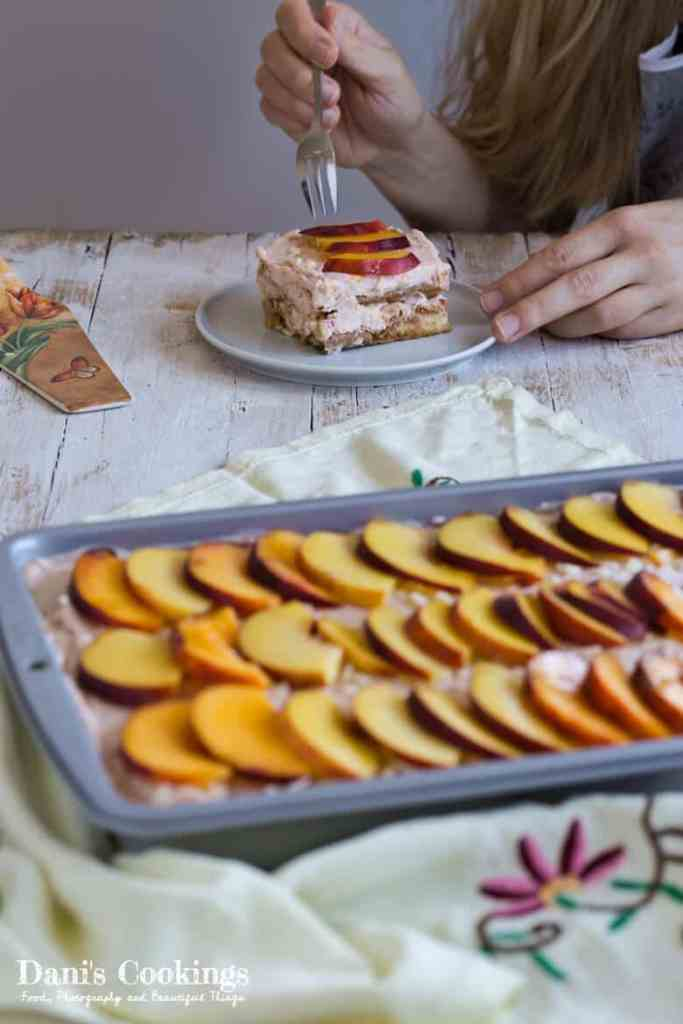 Peach Raspberry Tiramisu - a slice on a plate eaten with a fork and the pan on a side