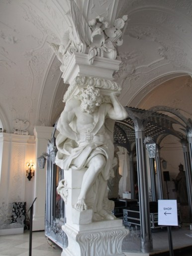 Carved column, statue of Hercules