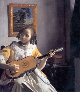 "The guitar in ""Young woman playing a guitar"" is not a modern design."