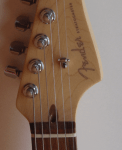Newer Fender has easier access to truss rod