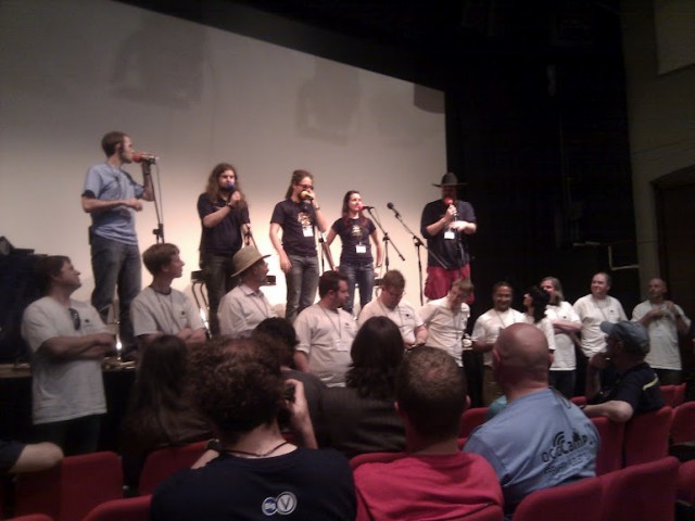 A picture of the two podcast crews on stage in Farnham for OggCamp 11