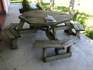 I liked this picnic table because it seats 8 in a circle and there is room for everyone's feet.