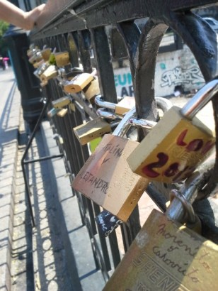 """A solution for reducing grafitti. There are hundreds of padalocks on the railing of this bridge in Santiago, each has someone`s name on it. Presumably they meet the need for people to write """"Joe was here""""."""