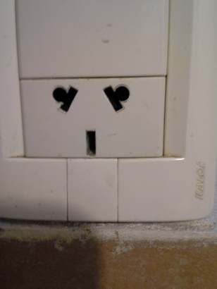 A power outlet in Argentina. I wonder whether they purposely made it look like a face.