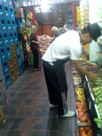 The guy who sold us vegetables. He picks them out for you, very quickly.