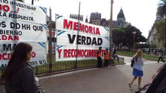 A poster outside the Presidential Palace, asking to remember the disappeared.