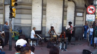 A band playing in a street fair