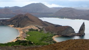 Iconic Galapagos view from bartolome island looking to volcano on santiago island