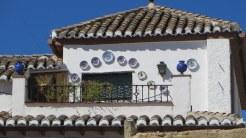 Pretty plates on house in Albecin, Granada