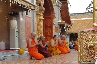 Biddhists praying at dusk at the Doi Suthep temple near Chiang Mai