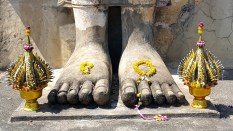 Offerings at the feet of a giant Buddha