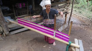 This woman is setting up the warp of the loom - she asked Char how old she was. This lady is younger than Char