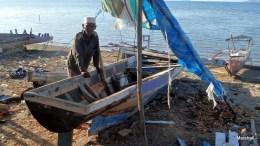 Man repairing his boat