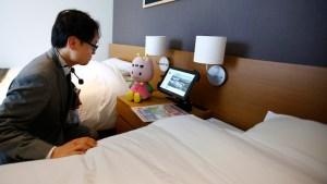 "A hotel staff talks with concierge robot ""Chu-ri-Robo"" at Robot hotel ""Henn na Hotel"" in Sasebo, western Japan, Wednesday, March 15, 2019. (AP Photo/Shizuo Kambayashi)"