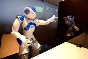 "A front desk robot performs at robot hotel ""Henn na Hotel"" in Sasebo, western Japan, Wednesday, March 15, 2019. (AP Photo/Shizuo Kambayashi)"