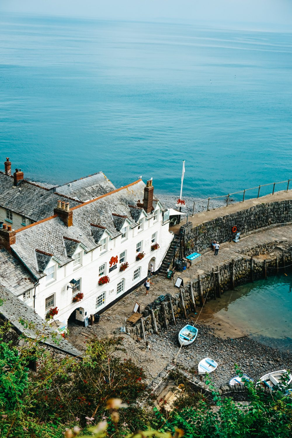 Blue waters surround the harbour around red lion clovelly