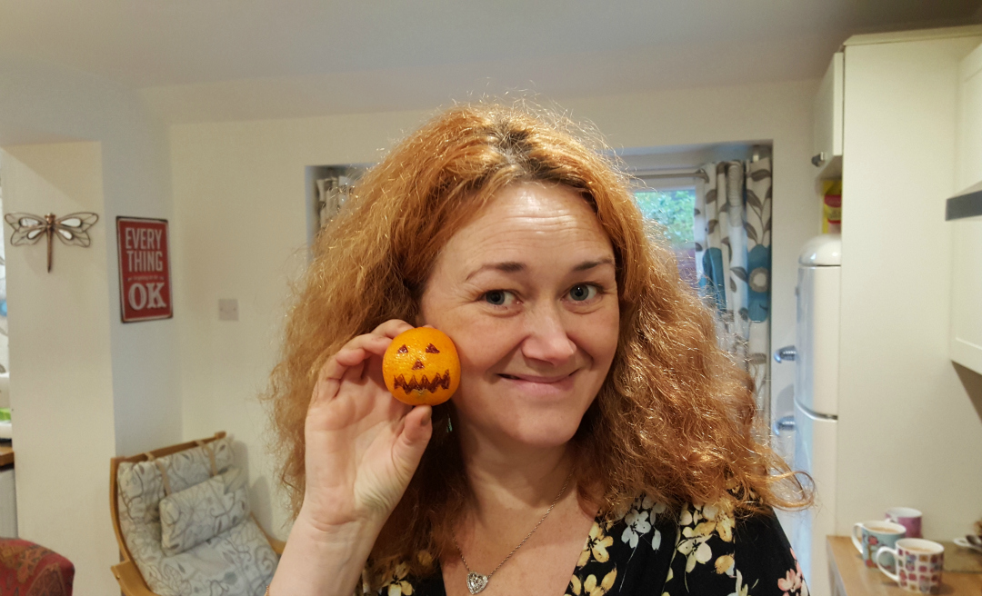 Moments of the month - November 2015 - 11-05 Mrs DannyUK with a pumpkin, I mean a tangerine - Taken from the DannyUK.com article Moments of the Month - Nov 2015