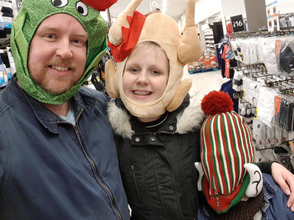 Dan, Brooke and Chance wearing festive hats