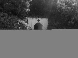 The main entrance to the Jersey War Tunnels: a tunnel cut directly into the mountainside, painted as a hospital entrance.