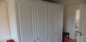 A pair of large wardrobes.