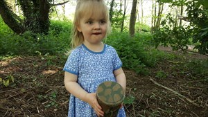 Annabel with a geocache.