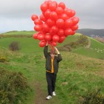 Hold on to your balloons... and hat!