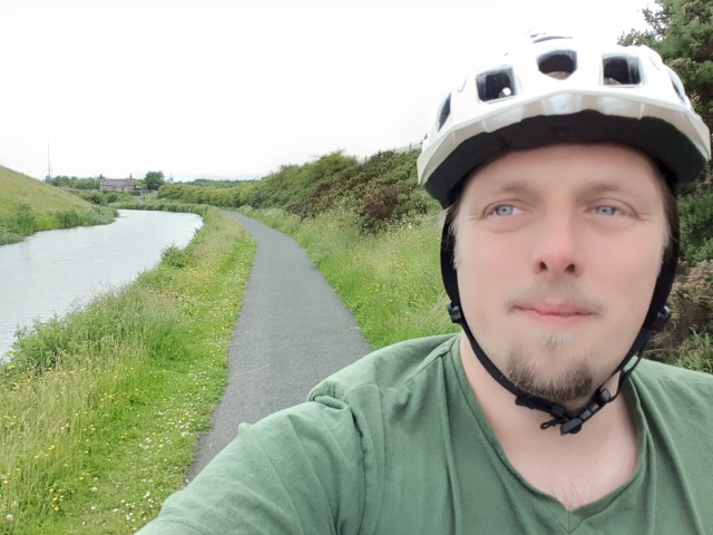 Dan cycling the Union Canal.