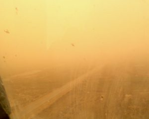 BT and Spock's aircraft are just visible through the sandstorm, 26 March 2003.  We fought several engagements in this weather before it became too dangerous.  Here we are moving north toward Al Shatra.  pg 177