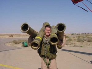Teddy Treadwell clowning around with empty TOW missile tubes at Ali Al Salem airfield in Kuwait, Oct 2000.