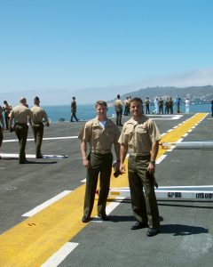 Gash (left) and I on the deck of the USS Belleau Wood as we pull out of San Diego Harbor in 2002, about nine months before the invasion of Iraq.