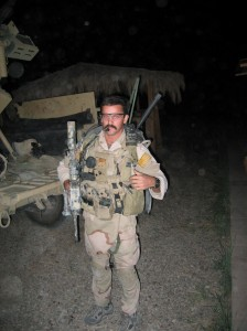 Prepping for a mission with MCSOCOM Det One, Baghdad 2004.  Armed with an M-4 and a .45cal Kimber, the radio on my back was my most lethal weapon.  pg 289