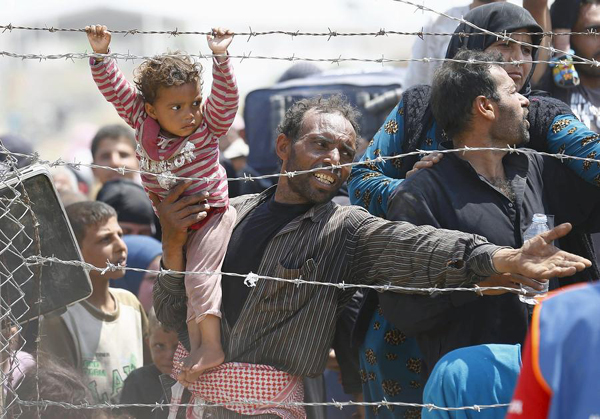 Refugiati sirieni la granita cu Turcia, 15 iunie 2015