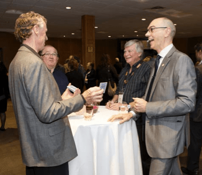 Dan Trommater performs magic with conference attendees