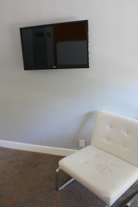 The TV and the chair (with pen all over it)