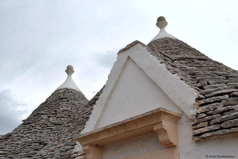 Bezoek zeker een trulli in Puglia als je op roadtrip in Italie bent