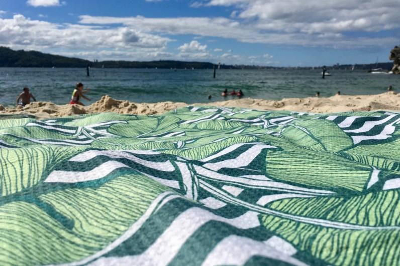 Teselate Handdoek op het strand in Sydney