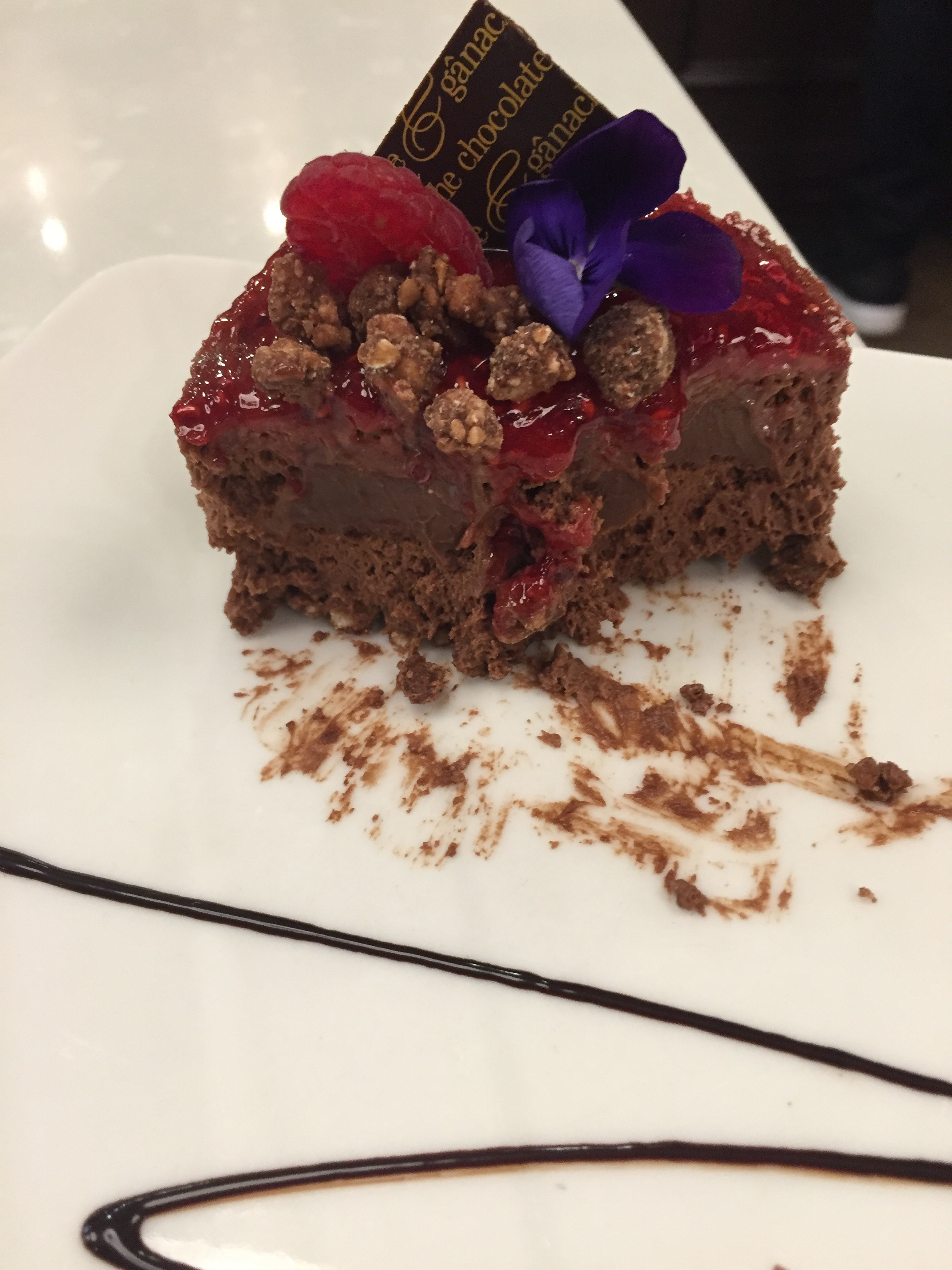 plate with partially eaten Raspberry Chocolate Mousse from Ganache Chocolate in Melbourne