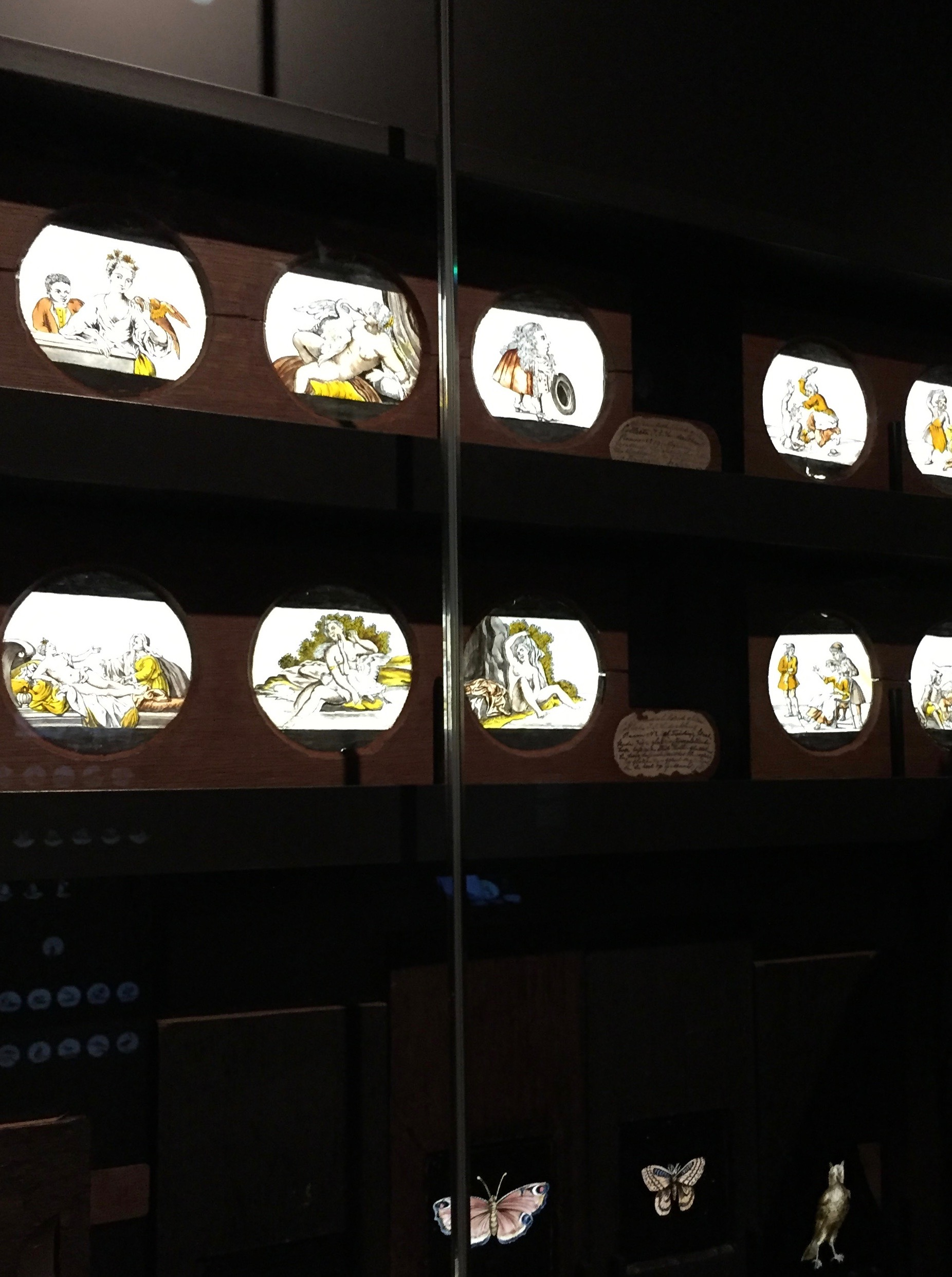 Eearly hand painted on glass picture slides in a glass case at the Rijksmuseum in Amsterdam