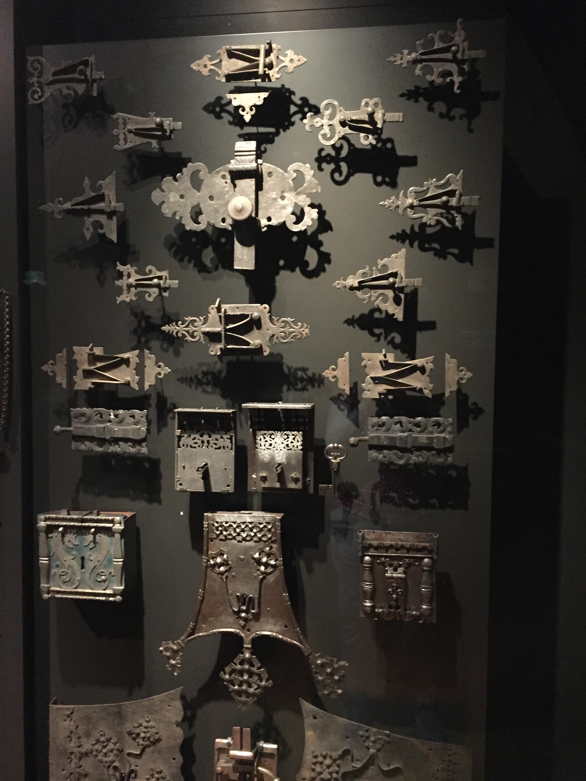 collection of locks in a glass case at the Rijksmuseum in Amsterdam