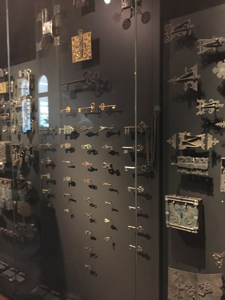 collection of keys and locks in a glass case at the Rijksmuseum in Amsterdam