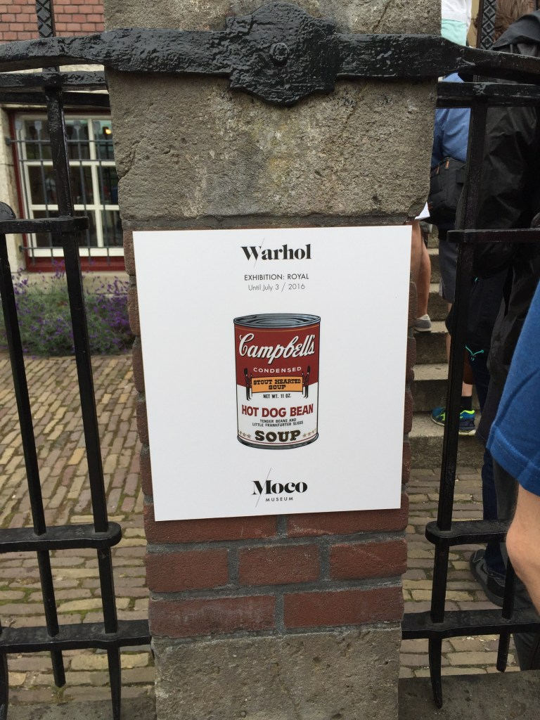 Moco Museum Warhol Campbell's Soup sign on the fence post outside of the museum in Amsterdam
